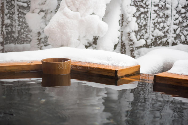 Japan hot spring. Japan natural mineral hot spring called onsen cover by snow in Japanese ryokan on the moutain okuhida takayama japan royalty free stock images