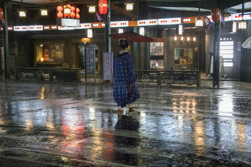 Japan, Kyoto - Portrait of traditional Japanese woman. Gion District at night stock image