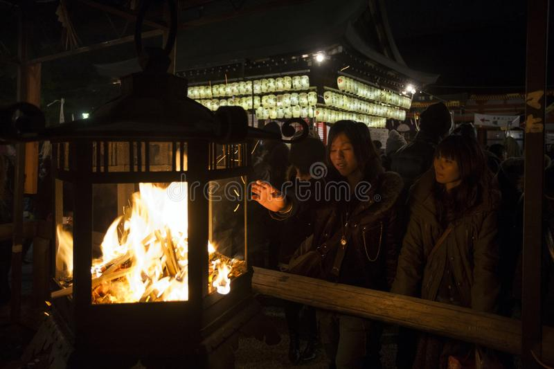 Japan - Kyoto - Yasaka temple cerebration. During the new years day japaneese make some propitious ritual for luck and wellness stock photos