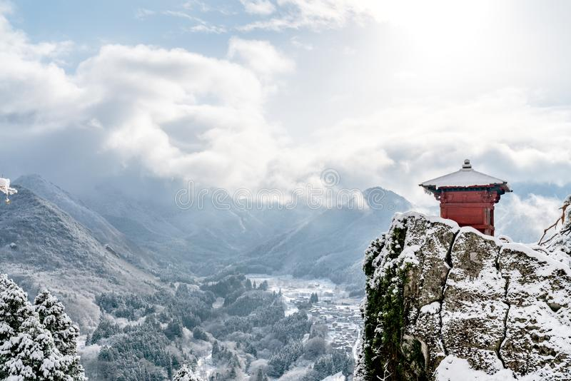 Japan landscape scenic view of red hall perched on rock cliff, yamadera shrine temple, yamagata prefecture, tohoku region, asia stock images