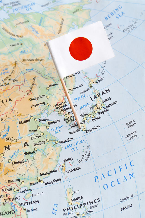 Japan map and flag pin. Paper flag pin of Japan on a map, a sovereign island nation in East Asia stock image