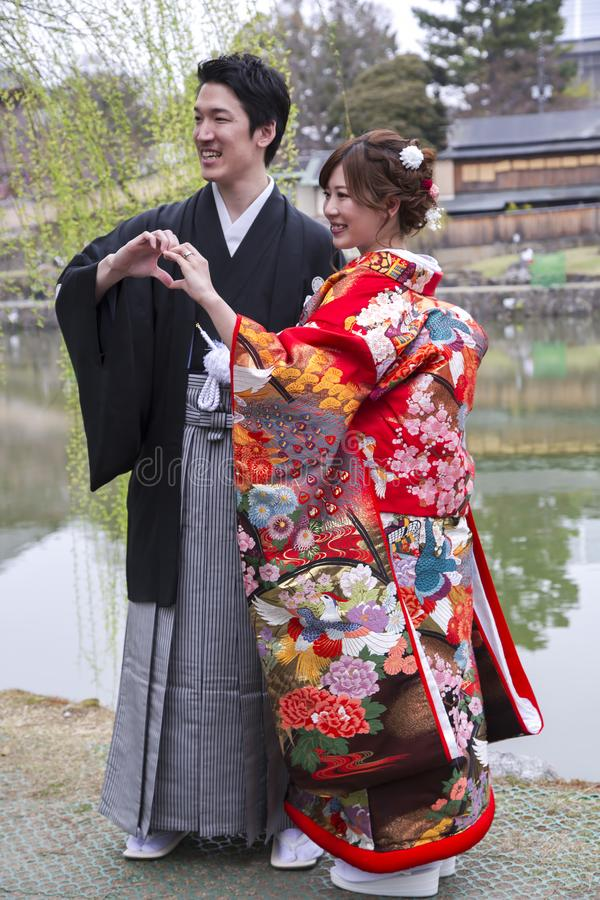 Japanese Wedding Kimono.Japanese Couple In Traditional Wedding Dresses Editorial Stock Photo