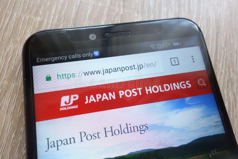 Japan Post-Holdingswebsite op een moderne smartphone wordt getoond die royalty-vrije stock afbeelding