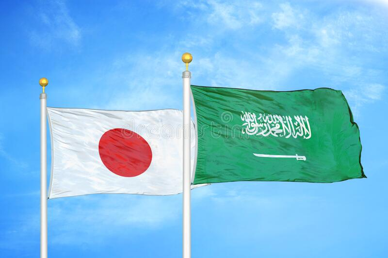 Japan and Saudi Arabia two flags on flagpoles and blue cloudy sky. Background royalty free illustration