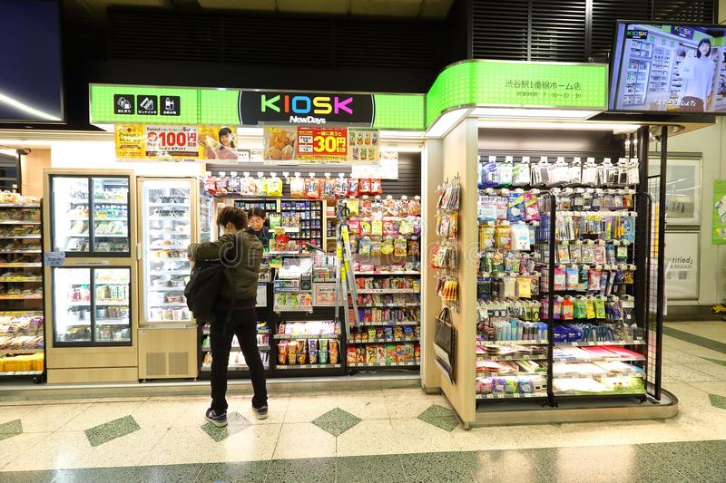 Japan: shops in train station. Shops in 1 of the many train stations in Tokyo. Customer buying items royalty free stock images