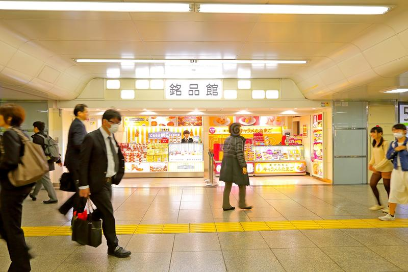 Japan: shops in train station. Shops in 1 of the many train stations in Tokyo. Crowd walking by royalty free stock photo