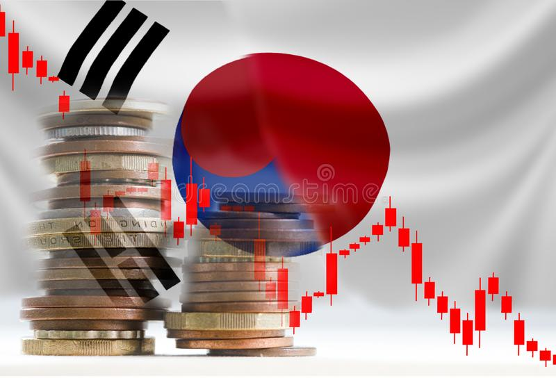 Japan and South Korea flag with decline stock bar graph.Now both countries have economic tariffs trade war and patriotic conflict. Japan and South Korea flag royalty free stock photos