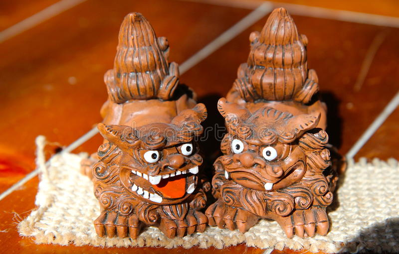 Japan souvenir. My daughter brought me these little souvenirs from Japan. Bad spirit at left opens mouth for bad things arrive but right dragon catch them and royalty free stock images