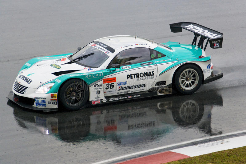 Japan Super GT 2009 - Lexus Team Petronas TOM's. Image of Lexus Team Petronas TOM's using a Lexus SC430 in action in the rain at the Japan Super GT Race held at royalty free stock images