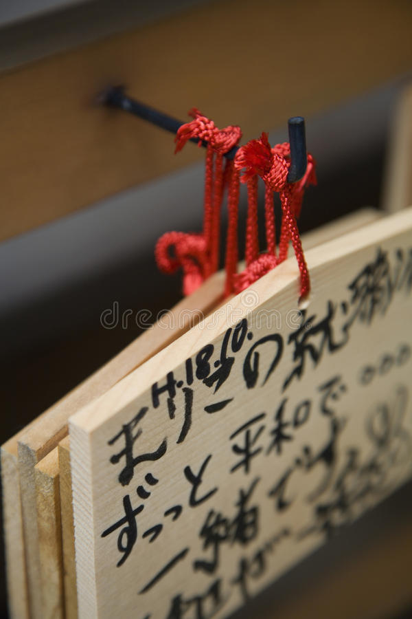 Japan Takayama Small wooden plaques with prayers and wishes (Ema) hanging on hook royalty free stock photo
