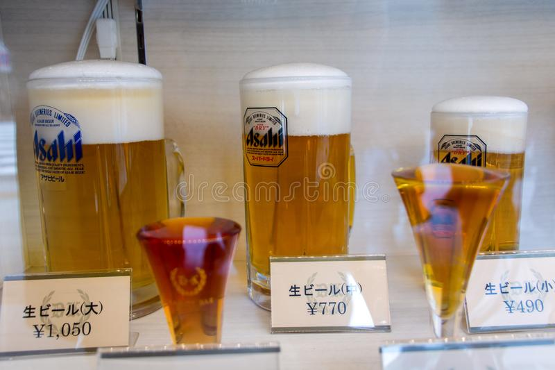 Imitation glass full of beer in a shop. royalty free stock photo