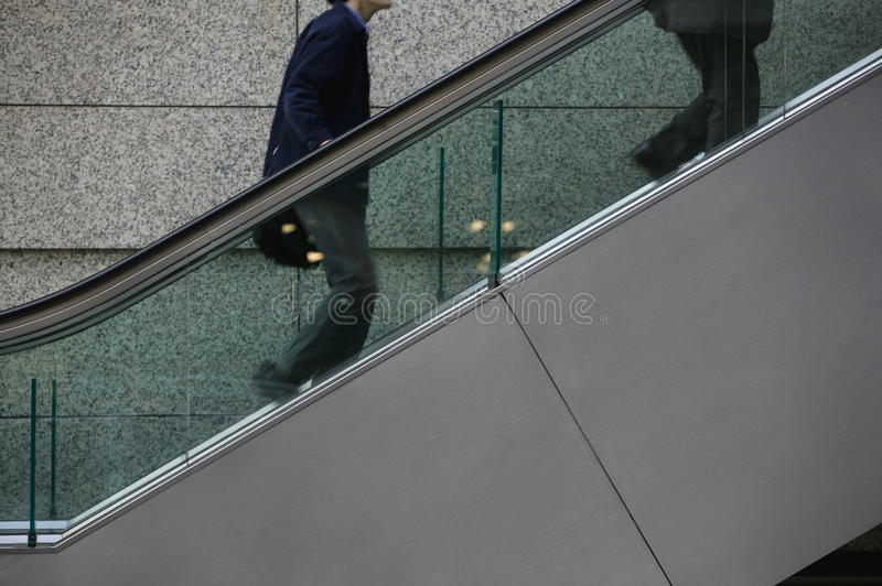 Japan Tokyo Tokyo International Forum two men ascending escalator mid section royalty free stock photo