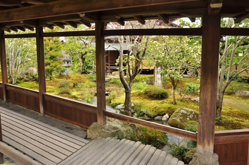 Japan zen temple garden. Japanese traditional zen temple garden detail and covered wooden walkway. Meditative space stock photos