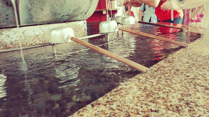 Japanase shinto shrine water pavilon royalty free stock photos