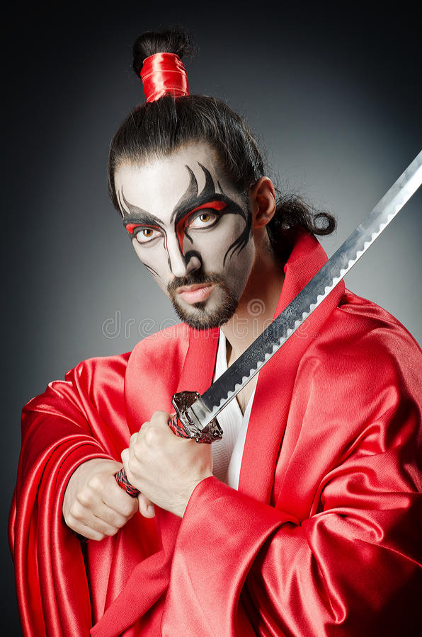 Japanese actor with sword. On black royalty free stock images