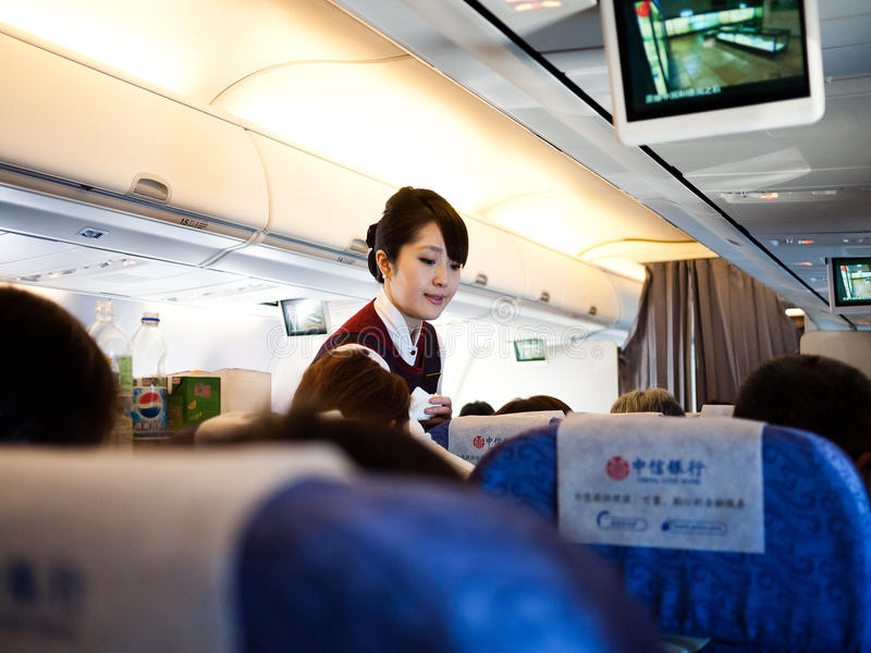 Japanese airline hostess in plane royalty free stock photos