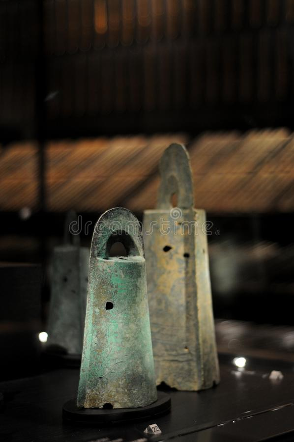 Japanese Ancient Bronze Ware Bells in Yayoi Era, about 2000 years ago. Many of bronze wares were found in Izumo, Japan. In summer royalty free stock image