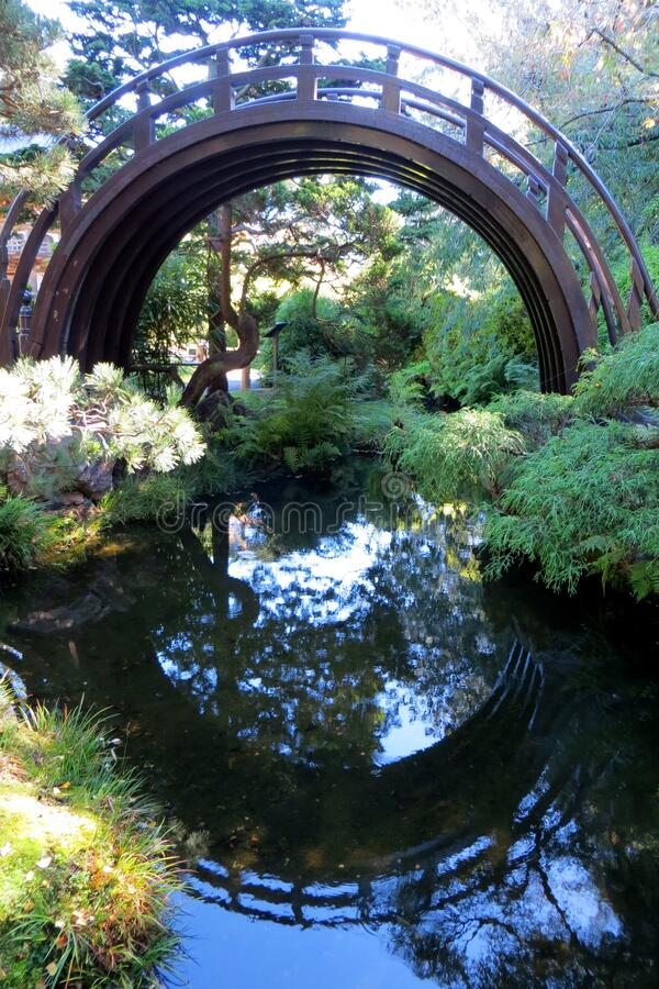 Japanese arched bridge with reflection stock photography