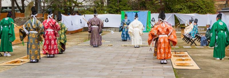 Japanese Archery Demonstration Begins. KOKURA, KITAKYUSHU, JAPAN - FEBRUARY 26, 2017: Traditional Japanese archery masters begin a kyudo demonstration with stock images