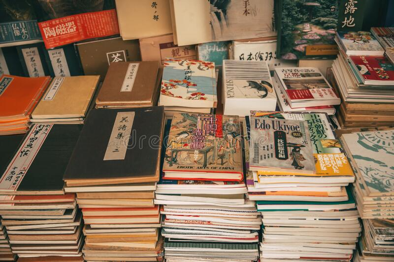 Japanese book such as novel cartoon text second hand pile stack sale in old used book store in Kyoto, JAPAN.,2 December 2017 royalty free stock images