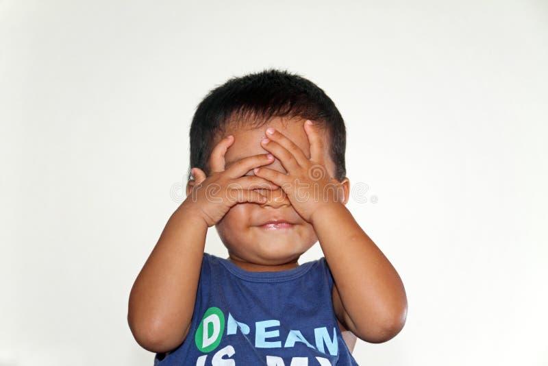 Japanese boy playing peek-a-boo. (1 year old stock photo