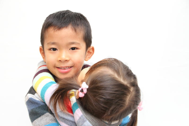 Japanese brother and sister hugging each other. 7 years old boy and 2 years old girl stock images
