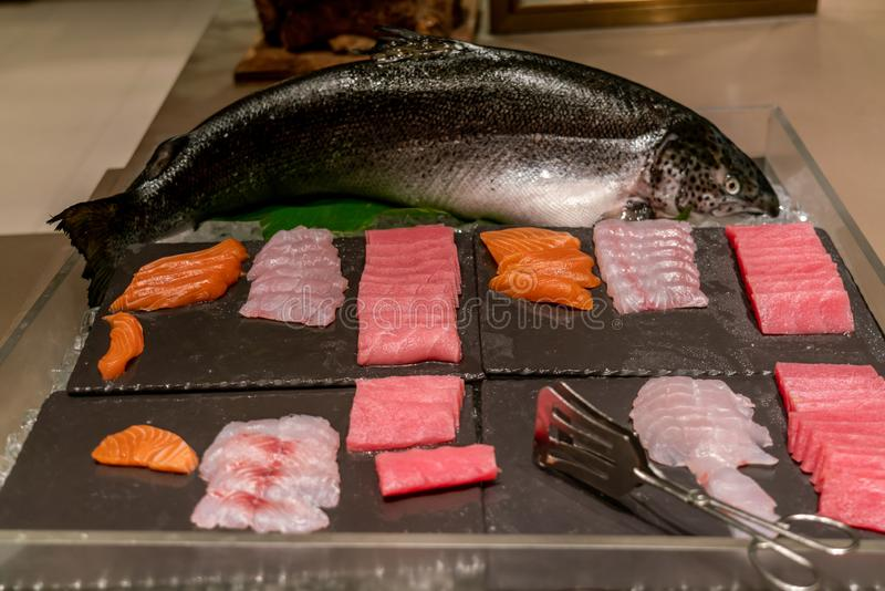 Japanese buffet with different Sashimi. Japanese buffet food with many different Sashimi stock photos