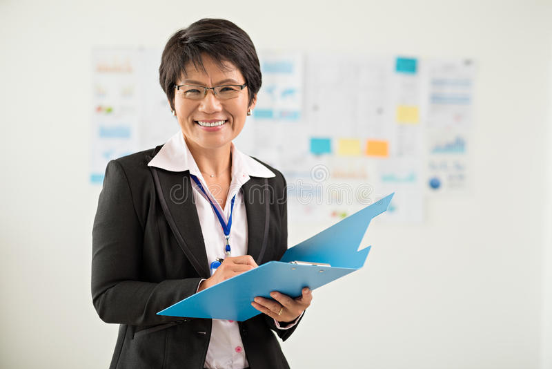 Japanese business lady. Portrait of Japanese business lady with a folder royalty free stock photo