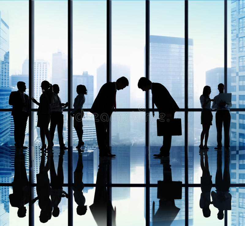 Japanese Business People Bowing Down Office Concept stock photography