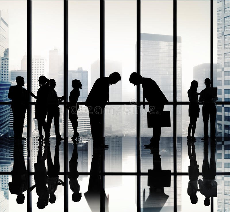 Japanese Business People Bowing Down Office Concept royalty free stock photography