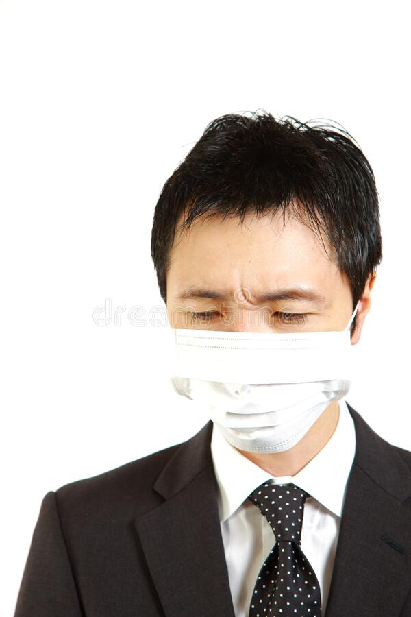 Japanese businessman with mask. Concept shot of Japanese businessman stock photography