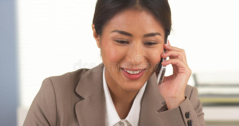 Japanese businesswoman talking on smartphone royalty free stock image