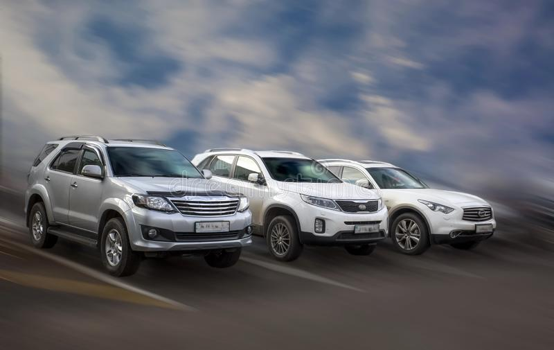 Japanese cars. Japanese cars on blurred in motion background stock photo
