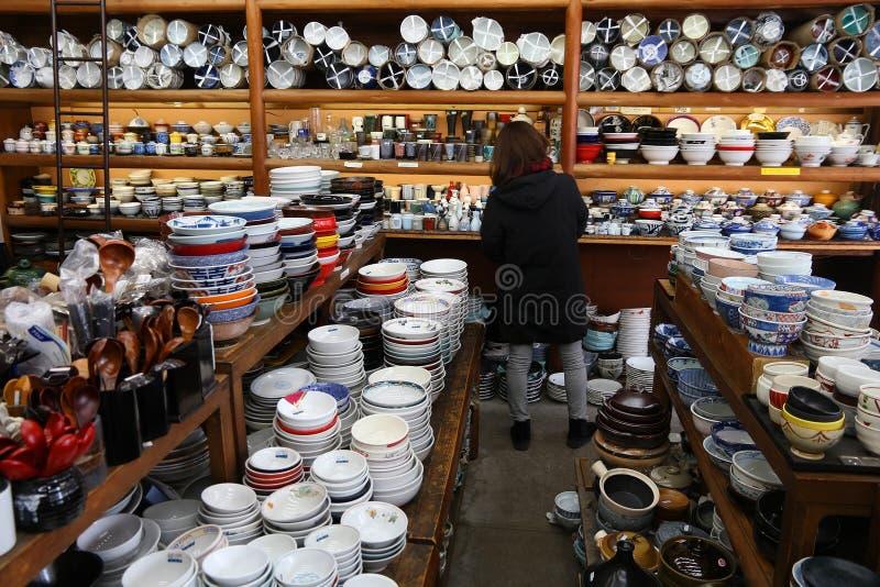 Japanese ceramics shop. TOKYO, JAPAN - DECEMBER 4, 2016: Japanese ceramic tableware store Kappabashi area of Asakusa in Tokyo, Japan. Kappabashi Street is known stock photography