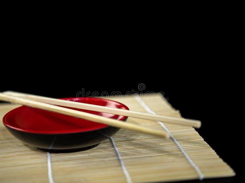 Japanese chopsticks on soy dish. Hashi with white background stock images