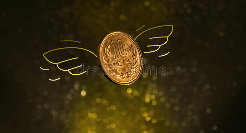 Japanese Coin Flying with Wings in the Golden Light. Japanese Coin with wings over golden light background, Money Finance Concept stock photos