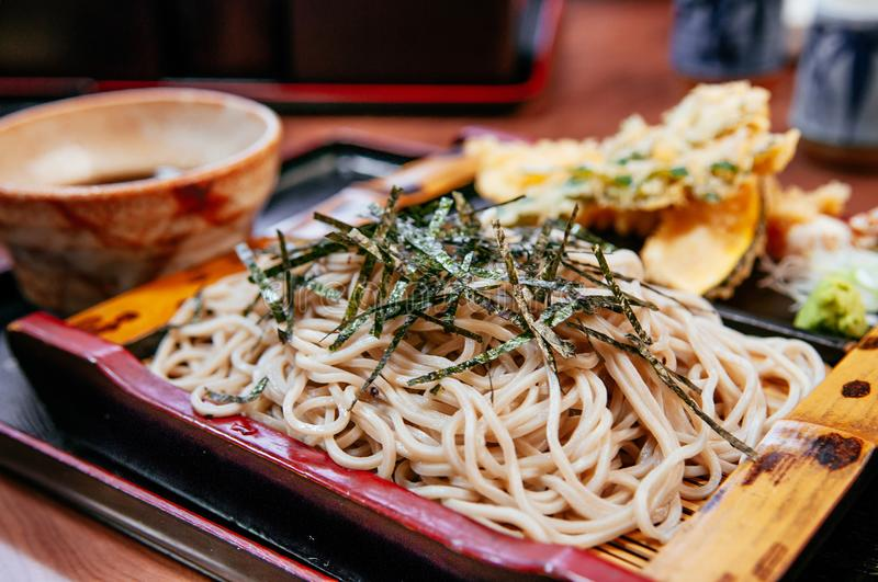 Japanese cold soba noodle on bamboo plate with Shrimp and vegetable tempura. Side view shot stock images