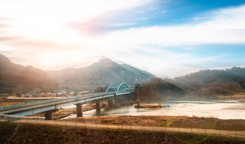 Japanese countryside with Railroad tracks bridge stock image