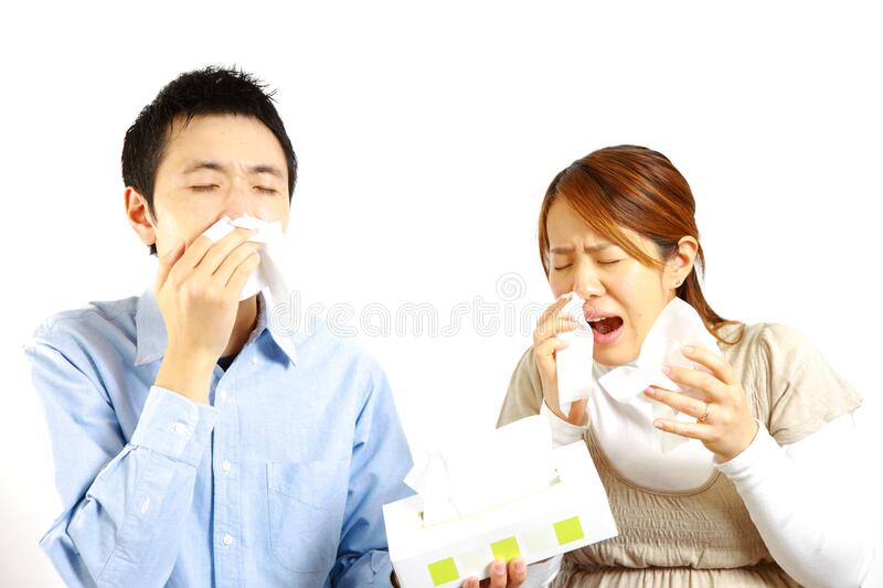 Japanese Couple suffers from allergic rhinitis . Concept shot of Japanese people stock photo