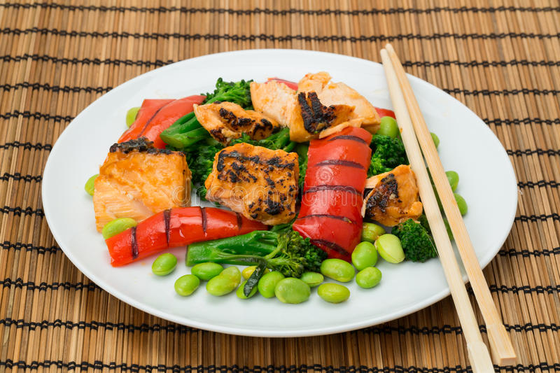 Japanese cuisine - Chargrilled Salmon teriyaki. With chopsticks stock images