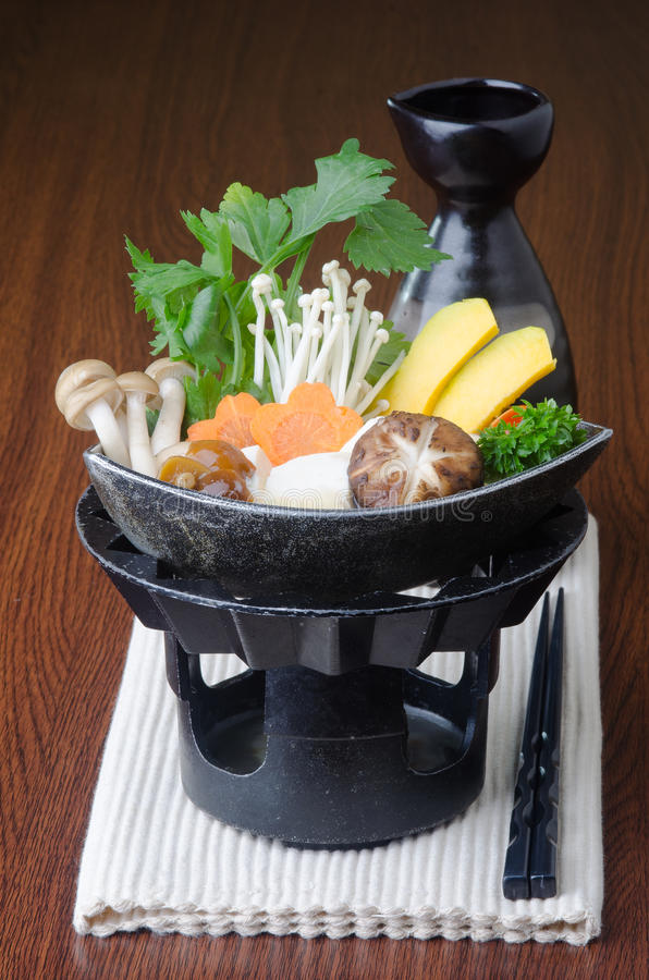 Japanese cuisine. hot pot on the background royalty free stock photo