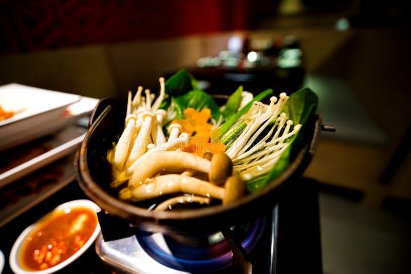 Japanese cuisine hot pot on background stock photos