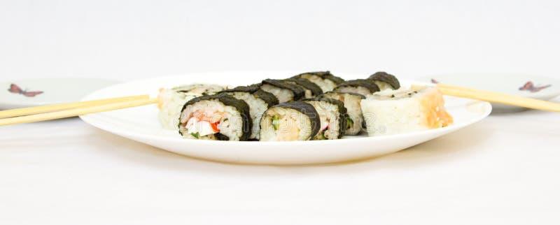 Japanese cuisine, rice sushi and fish - closeup. Vegetarian dish royalty free stock photo