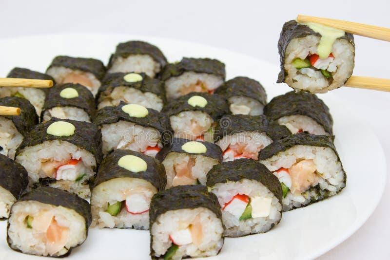 Japanese cuisine, rice sushi and fish - closeup. Vegetarian dish royalty free stock photography