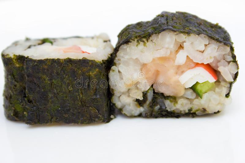 Japanese cuisine, rice sushi and fish - closeup. Vegetarian dish stock image