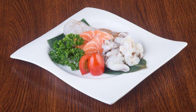 Japanese cuisine. sashimi on the background. Japanese cuisine. sashimi on background stock photo