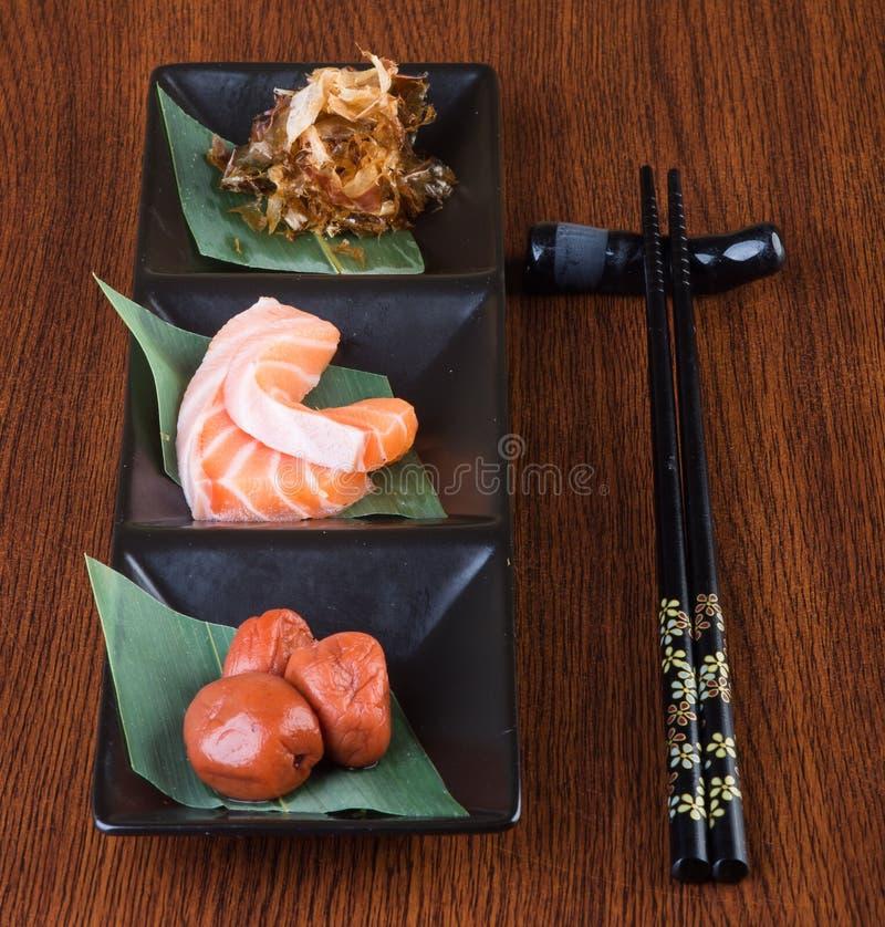 Japanese cuisine. sashimi on the background. Japanese cuisine. sashimi on background stock image