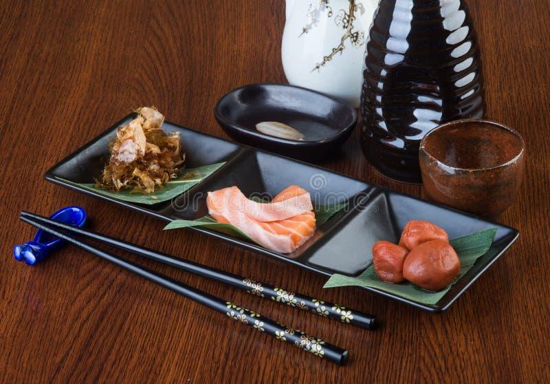 Japanese cuisine. sashimi on the background. Japanese cuisine. sashimi on background royalty free stock image