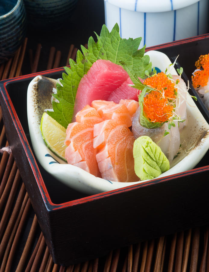 Japanese cuisine. sashimi on the background. Japanese cuisine. sashimi on background stock photography