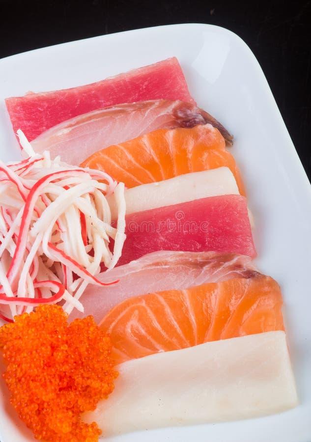 Japanese cuisine. sashimi on the background. Japanese cuisine. sashimi on background royalty free stock photography